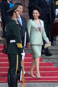 Chinese first lady Peng Liyuan, right, and Chinese President Xi Jinping arrive for a welcome ceremony for the Sri Lankan President, unseen held at the Great Hall of the People in Beijing, China, Tuesday, May 28, 2013. (AP Photo/Ng Han Guan)