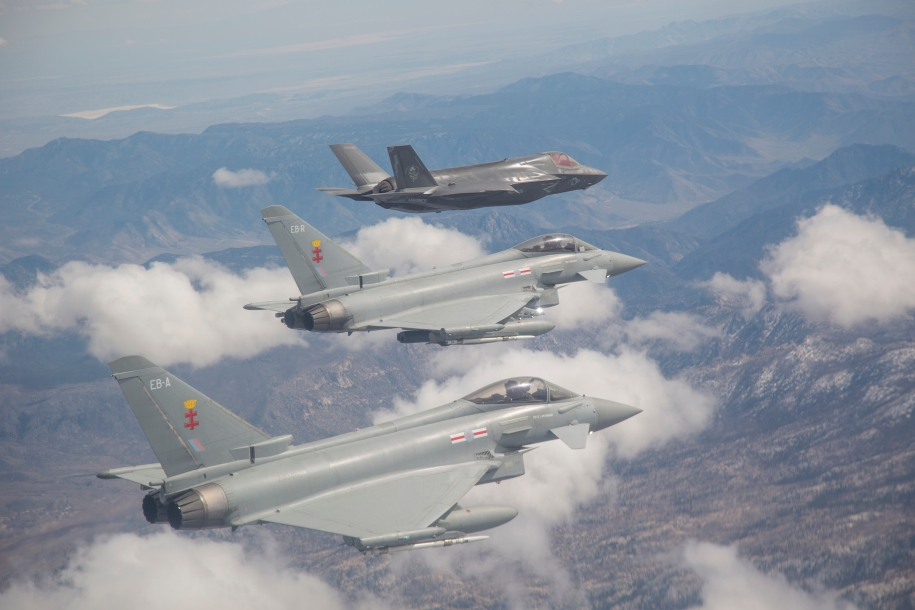 """F-35 BF-17 from the F-35 Integrated Test Force in Formation with RAF Typhoons, Edwards AFB, CA April 4, 2014 F-35 test pilot LtCol Jon """"Miles"""" Ohman performs interoperability testing."""