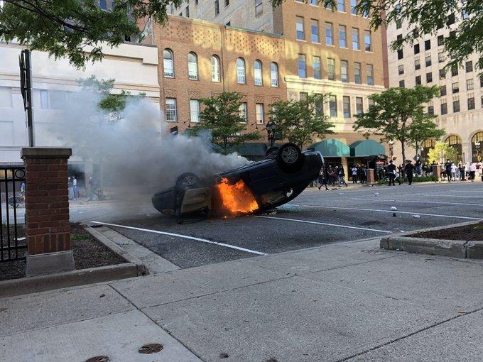 Car on fire Lansing protests driver arrested